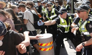 Police use pepper spray against protesters.