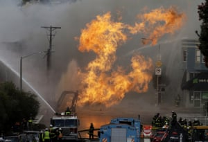 Firefighters battle a blaze on Geary Boulevard in San Francisco after a gas explosion.