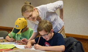 Hannah Rodabaugh assists students at the Log Cabin Literary Center in Boise, Idaho.