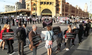 Animal rights protesters block a Melbourne intersection. The attorney general wants states to boost trespass penalties in response to protests