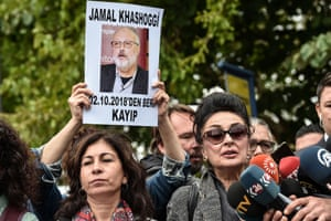 President of Turkey's Human Rights Association (IHD) Eren Keskin (R) speaks to journalists during a demonstration in front of the Saudi Arabian consulate in Istanbul, in support of missing journalist and Riyadh critic Jamal Khashoggi, on 9 October