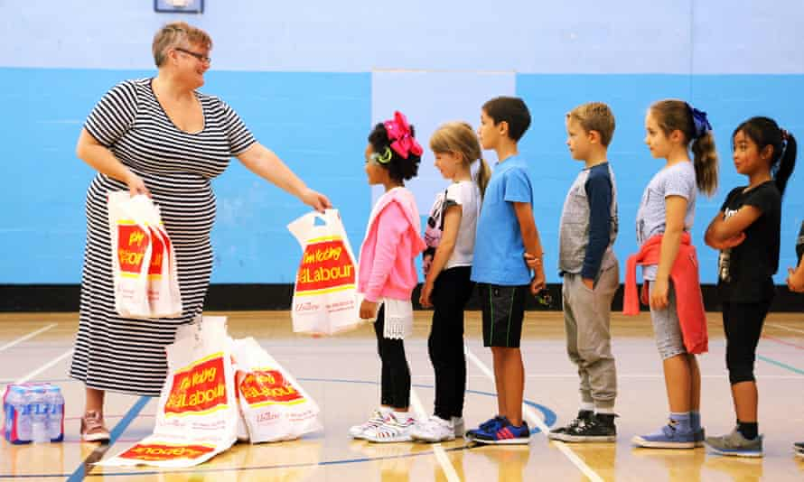 Carolyn Harris MP hands out free lunches to children in Swansea, UK.