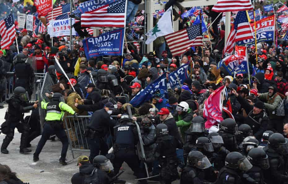 Rioters clash with police and security forces as they storm the US Capitol.