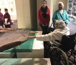 A Barkindji elder touches a bark canoe