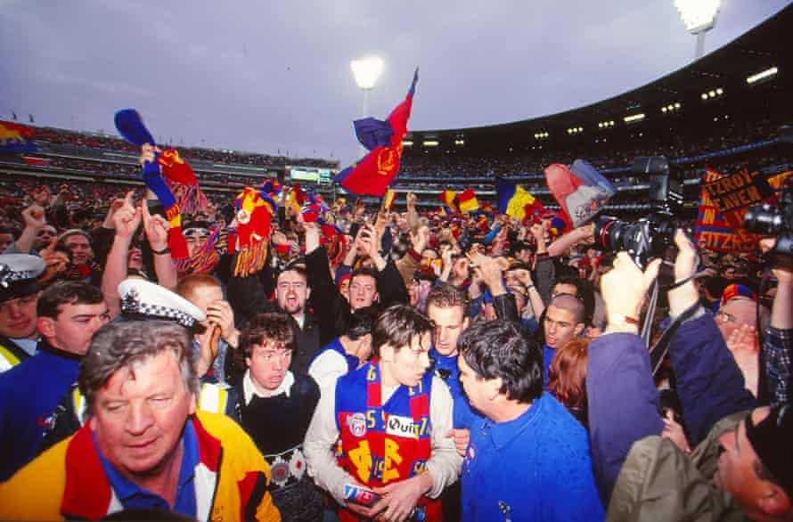 Fitzroy fan flood the playing arena