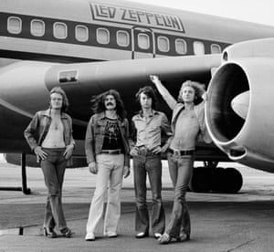 John Paul Jones, John Bonham, Jimmy Page and Robert Plant of Led Zeppelin in front of plane in NY. July 24, 1973