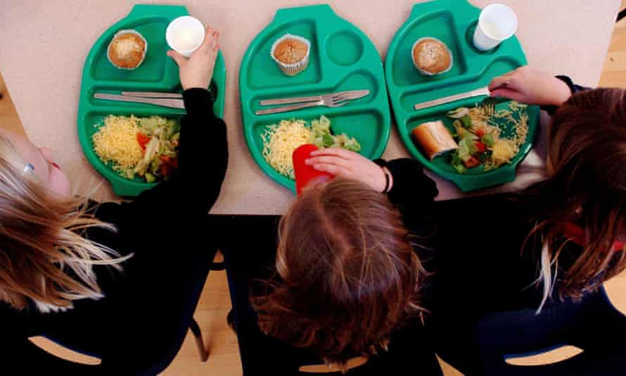 Overhead view of pupils eating school meal