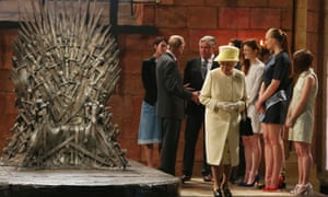 Queen Elizabeth admires the iron throne on a visit to the set of Game of Thrones in Northern Ireland.