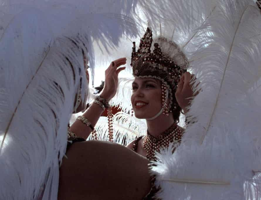 Woman adjust their headdresses before the Carnival in Port of Spain, Trinidad.