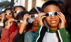 School children watch a solar eclipse outside the planetarium in Jakarta, Indonesia 9 March, 2016.