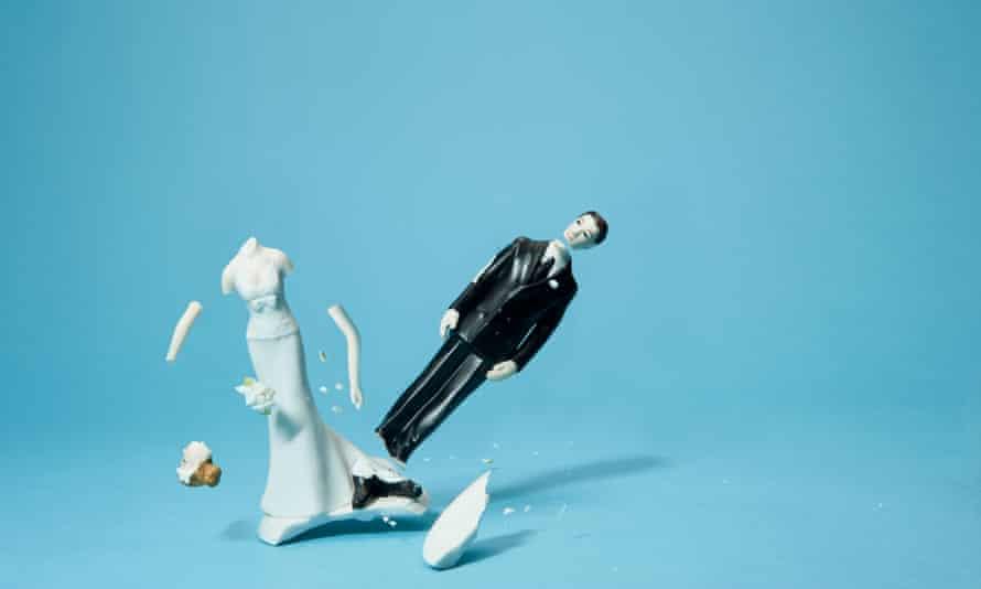 Bride and groom cake topper smashing apart