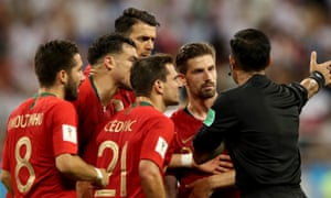 Iran v Portugal: Group B - 2018 FIFA World Cup Russia<br>SARANSK, RUSSIA - JUNE 25:  Portugal players surround the referee during the 2018 FIFA World Cup Russia group B match between Iran and Portugal at Mordovia Arena on June 25, 2018 in Saransk, Russia.  (Photo by Clive Mason/Getty Images)