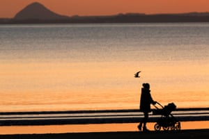 Dawn on Portobello beach at daybreak in the Firth of Forth with North Berwick Law on the horizon
