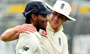 Jofra Archer and Stuart Broad leave the field as rain stops play at Seddon Park