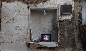 Ain Terma, SyriaPeople watch the World Cup final in their war-damaged home in the eastern Ghouta suburb of Damascus