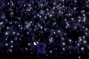 Bangkok, Thailand, Pro-democracy protesters flash lights from their phones during an anti-government protest