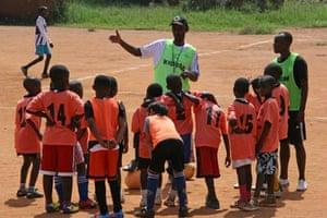 Eric Eugène Murangwa instructs children at one of the Dream Team academies he runs in Rwanda. 'We bring children together around football and teach them to celebrate their diversity,' he says.