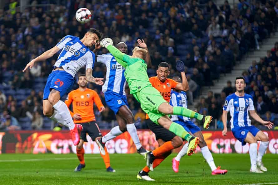 The Rio Ave goalkeeper Pawel Kieszek competes for the ball with Porto's Tiquinho Soares during the game on 7 March