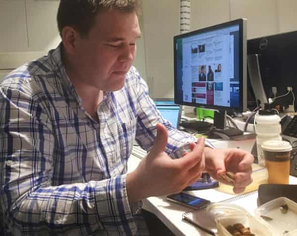 Dave Earley samples the new chocolate bar in the Guardian Australia newsroom.