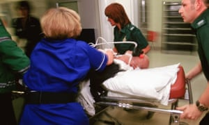 Ambulance crew bring patient into hospital