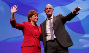 Scotland's first minister Nicola Sturgeon and her deputy John Swinney on stage at the Scottish National party conference in Glasgow.