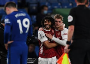 Arsenal's Mohamed Elneny (left) and Emile Smith-Rowe celebrate the Gunners' victory.