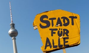 A placard reading 'city for all' is pictured in Berlin