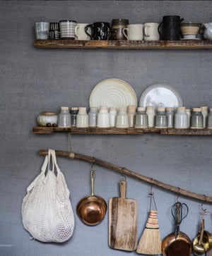 A branch as hanging rack, with beaten copper hooks, exemplifies the beauty of Tennessee photographer Beth Kirby's kitchen – a Jersey Ice Cream Co special; @localmilk