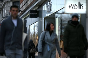 Pedestrians walk past closed-down Topshop and Wallis clothes stores in central London.