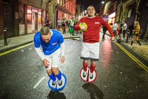 A pair of Subbuteo players turn the town centre into a table football pitch