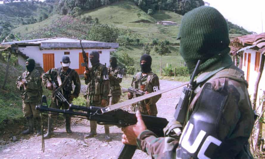 A group of AUC (United Self-Defense Forces of Colombia) paramilitary forces keep watch in Tulua, about 200 miles southwest of Bogota, on 3 October 1999.