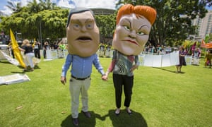Protesters dressed as caricatures of Tim Nicholls and Pauline Hanson in Brisbane on Tuesday
