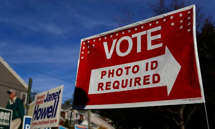 A sign in Arlington, Virginia, on 5 November 2019. Kentucky approved a new photo ID requirement that makes it harder to vote.
