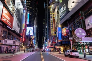 An empty Times Square is seen on the street following the outbreak of coronavirus disease in New York City.