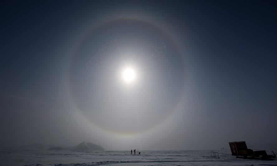 Scientists measure solar radiation, at the Glaciar Union camp in the Antarctica