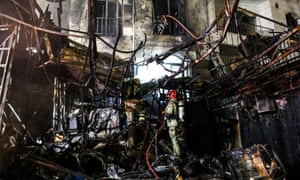 The scene of an explosion at the Sina At'har health centre in the north of Iran's capital Tehran after a powerful gas explosion.