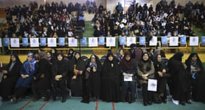 Iranian women, among them activists in the foreground, attend a reformists campaign rally for the parliamentary elections in Tehran.