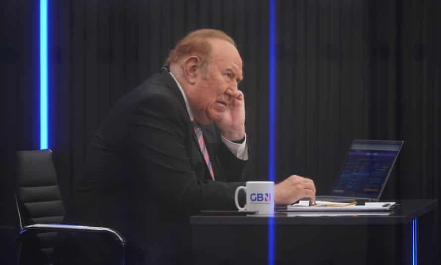 Andrew Neil prepares to broadcast from a studio during the launch event for GB News