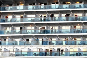 People wave from the cruise ship Ruby Princess as it departs Port Kembla, south of Sydney. The cruise ship became the source of a major Covid outbreak after it had docked in Sydney.
