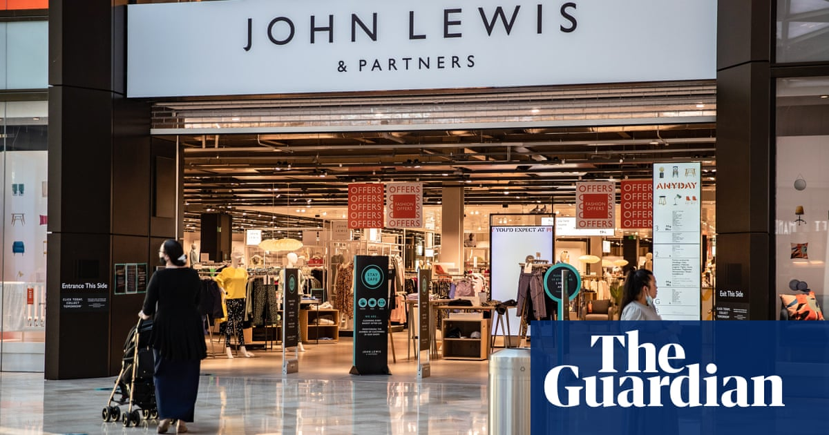 John Lewis cuts losses to £29m but warns of Christmas shortages