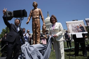 Nancy Pelosi and Chinese dissident Yang Jianli unveil the Tank Man statue during a rally to commemorate the 30th anniversary of the Tiananmen Square massacre