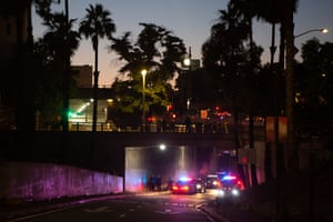 A freeway entrance is blocked by police cars to prevent protesters from re-blocking the freeway after a Black Lives Matter Protest in solidarity with other national demonstrations to show outrage over the death of George Floyd in downtown Los Angeles on Wednesday, May 27, 2020 in Los Angeles, CA.
