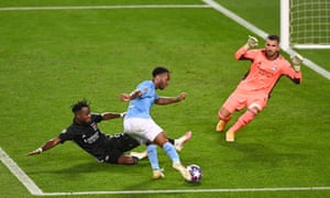 Raheem Sterling is thwarted by Maxwel Cornet.
