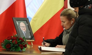 Woman signs book of condolence for Pawel Adamowicz in Warsaw