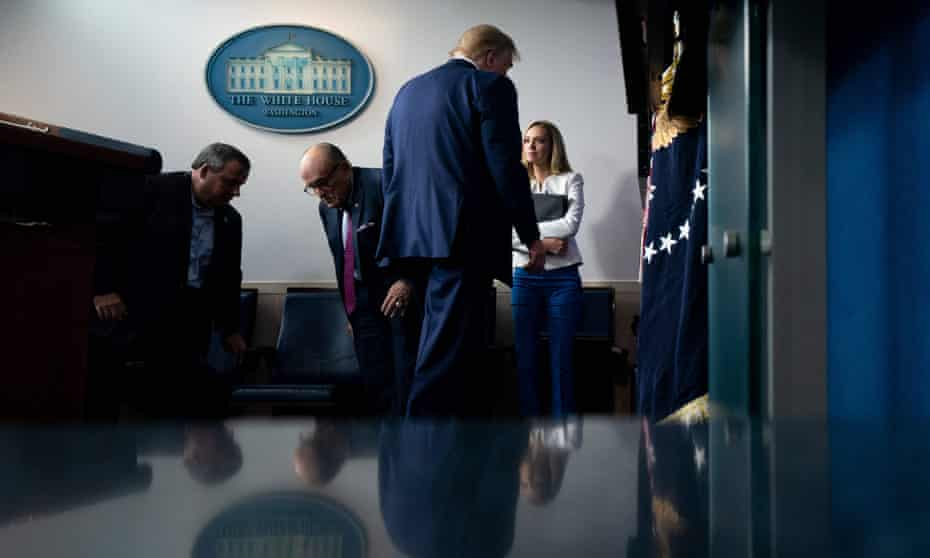 Donald Trump leaves after his White House briefing