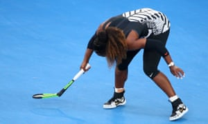 Serena Williams breaks her racquet.
