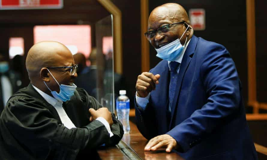 Jacob Zuma speaks with a member of his legal team at the high court in Pietermaritzburg, South Africa