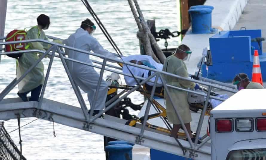 Medics transport a body from the MS Zaandam, Fort Lauderdale, Florida, 2 April.