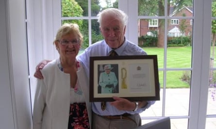Valerie and Peter Williamson with a framed letter of congratulations from the Queen, on their diamond wedding anniversary in 2019.