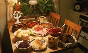 Feast daze … the Swedish Christmas julbord with cheese, potatoes, beets, meatballs, baked bread, roast ham and marinated herring.